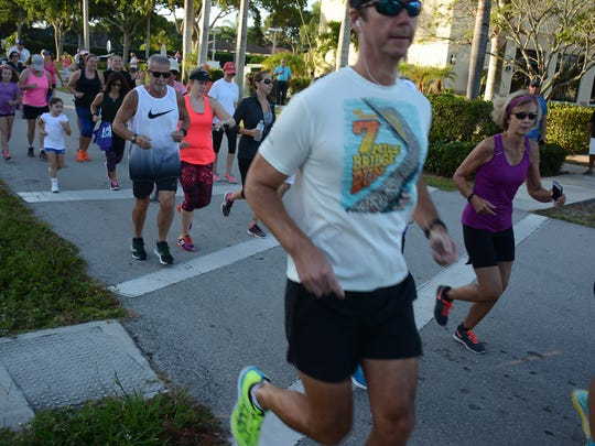 The group heads out from the Shops of Marco. Nearly 100 runners and walkers covered five kilometers Saturday morning on Marco Island, in an event benefiting the Shelter for Abused Women and Children in Naples.