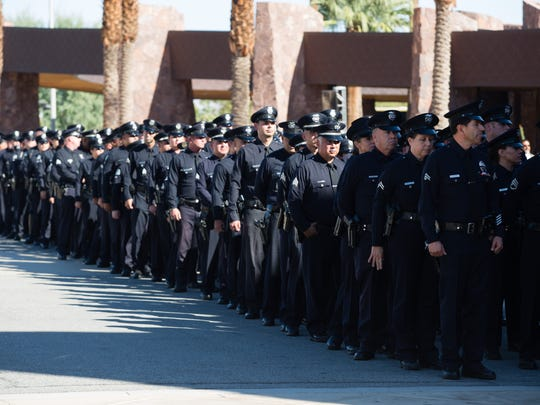 Police from the Los Angeles Police Department stand in formation outside of the Palm Springs Convention Center before entering for the funeral of Palm Springs Officer Lesley Zerebny, Tuesday, October 19, 2016.