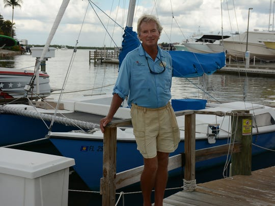 Capt. Tom Williams with 'Paradise,' the catamaran he sails daily. An excursion boat skipper for the Marriott who is also a published author, Williams is having one of his tales adapted as a television show for the Travel Channel.