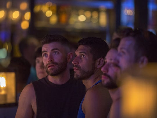 Patrons at LGBT-friendly Bar 10 in West Hollywood watch