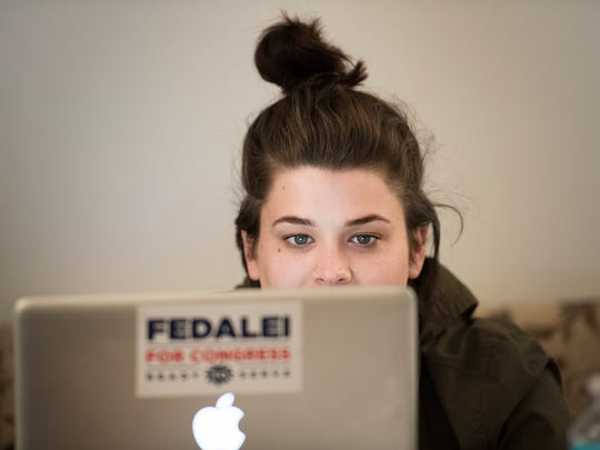 Connor Vetter, field organizer for Chris Fedalei, works on her laptop in their campaign headquarters in downtown Greenville on Tuesday, October 25, 2016.