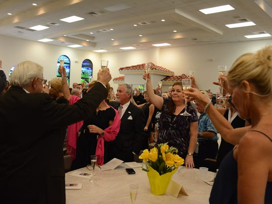 At the reception, guests raise their glasses for a toast. Hundreds gathered at San Marco Catholic Church on Wednesday morning for a memorial service honoring the life of island stalwart Dick Shanahan.