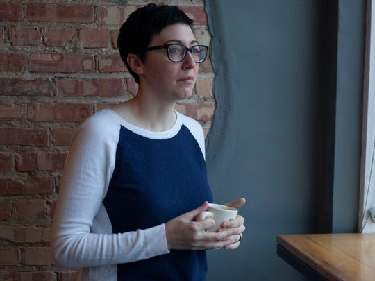 Cara Nader, owner of Strange Matter Coffee, poses for