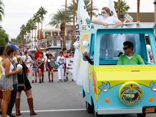 The City of Palm Desert Mystery Machine comes down El Paseo in the 52nd annual Palm Desert Golf Cart Parade Sunday, October 30, 2016.