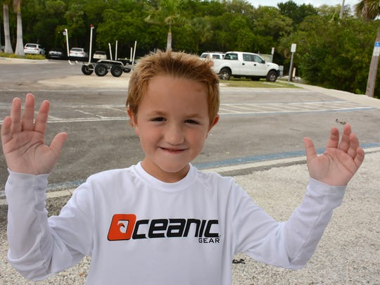 Tournament winner Luca Musico, 6, shows how big the fish he caught was. The Friends of Rookery Bay put on the third annual Guardian Anglers fishing tournament in the waters around Naples and Marco Island.