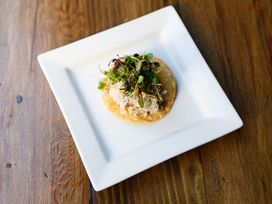 A fresh fish ceviche tostada is one of the bar snacks offered on Catalan's happy hour menu, October 20, 2016.