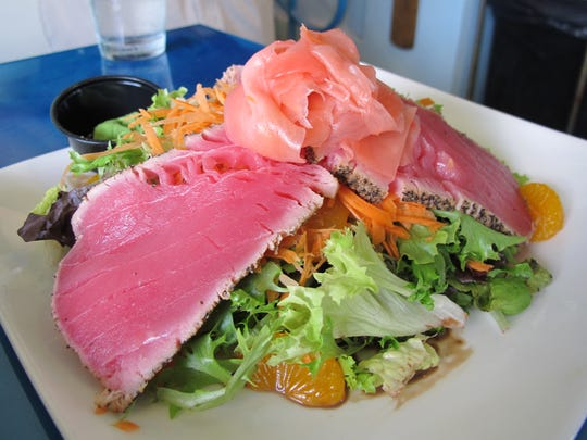 The yellowfin tuna appetizer at Deep Lagoon Seafood & Fish Market in North Naples is served with picked ginger, soy sauce, wasabi and a seaweed salad.