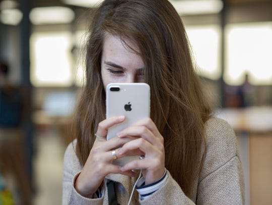 A customer takes a selfie with an iPhone 7 in the Apple Store in Madrid, Spain, Sept. 16th 2016. The iPhone 7 contains 24 grams of aluminum, much of it in an alloy used to make its case.