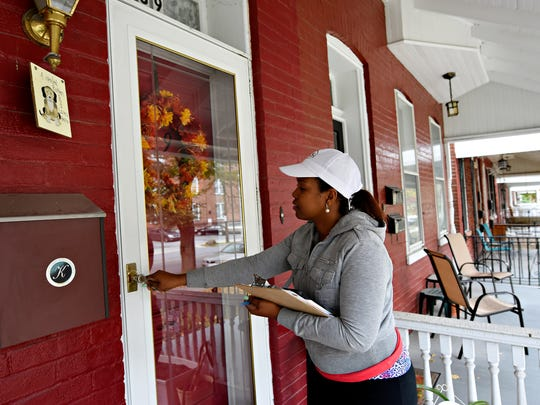 Joanna Guerrero, with CASA, knocks on doors to encourage residents on her list to vote and leaves them informational resources as part of a voting initiative in York City, Tuesday, Nov. 1, 2016. Dawn J. Sagert photo