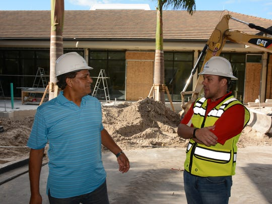 General manager Mac Chaudhry, left, speaks with project manager Brian Welsh of Manhattan Construction. The Marco Island Hilton has been closed since June 1 as the hotel undergoes a $40 million renovation.