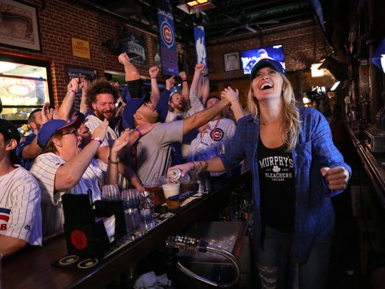 Go crazy, folks! Bartender Laura Blackburn and her patrons in a Chicago bar go berserk as the Cubs break the curse.