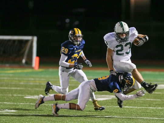 Greencastle-Antrim's Seth Eberly tackles Cormac Houpt