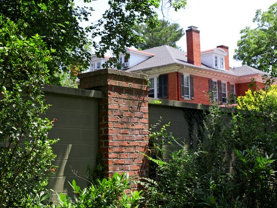 Debra Chilton-Belloni has been fighting to keep a wall that she and her husband had built around a 19th century house they bought 10 years ago to help reduce traffic noise along N. Augusta Street in Staunton in this photo taken on July 27, 2016. The city of Staunton said the wall was not built in accordance to the zoning regulations for a corner lot.