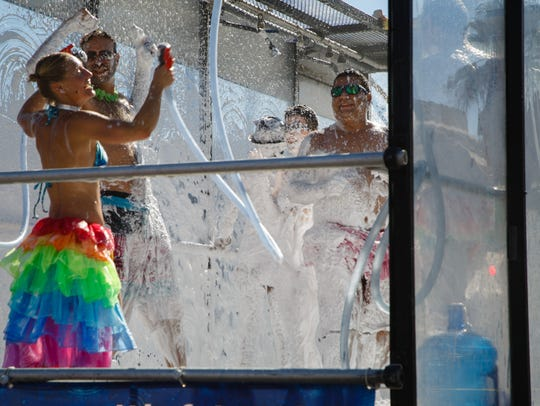 A float for Dr. Bronner's soap participates in the