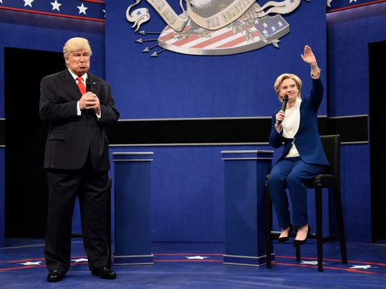 "In this Oct. 15, 2016 photo provided by NBC, Alec Baldwin, left, as Republican presidential candidate, Donald Trump, and Kate McKinnon, as Democratic presidential candidate, Hillary Clinton, perform during the during the ""Debate Cold Open"" sketch. (Will Heath/NBC via AP)"