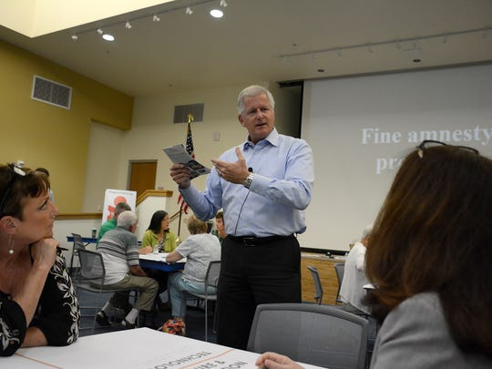 Moderator Tim Hancock of Stantec Consulting speaks to the group at one table. The Collier County Public Library system held the first of a series of public visioning workshops to help local libraries better serve the community, November 4 at the South Regional library branch on Lely Cultural Parkway.