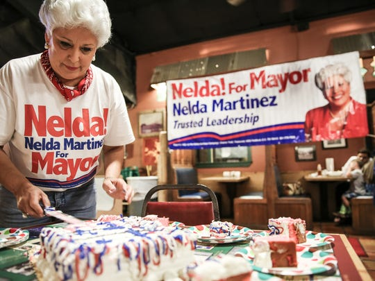 Mayor Nelda Martinez cuts slices of cake at the start of her election night  gathering Tuesday, Nov. 8, 2016, at Howard's BBQ.