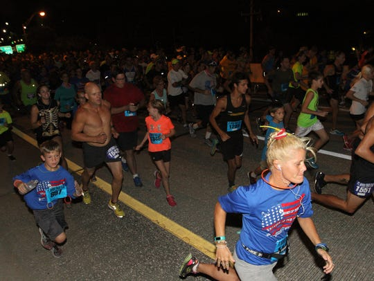 Competitors in the Veterans Day 5K run on Friday night,