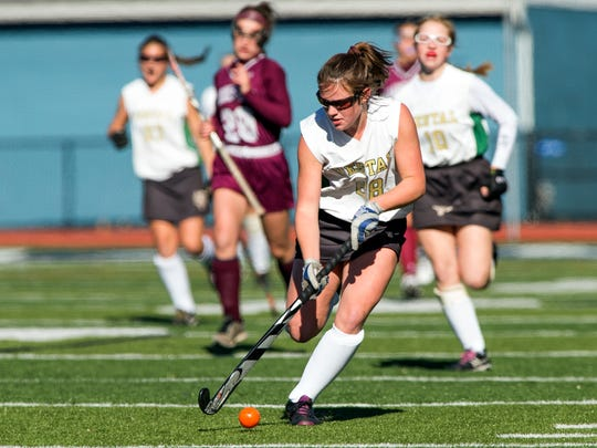 Vestal's Darby Matthews fights for possession of the ball with Garden City's Caroline Munn during the second half of the Class B field hockey state semifinal game at Maine-Endwell on Saturday, Nov. 12, 2016. Garden City defeated Vestal 3-1.