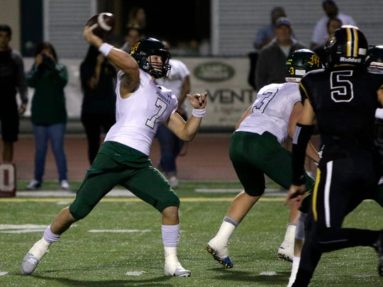 Moorpark High quarterback Tyger Goslin fires a pass during Friday night's playoff game at Ventura.