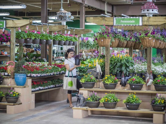"""Orchard Supply Hardware stores touted the Potting Bench section, where customers could purchase a plant and a pot and have it potted free of charge, allowing store personnel to do the """"dirty work."""""""