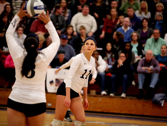 Lee's Addison Keatts prepares to spike a ball set by