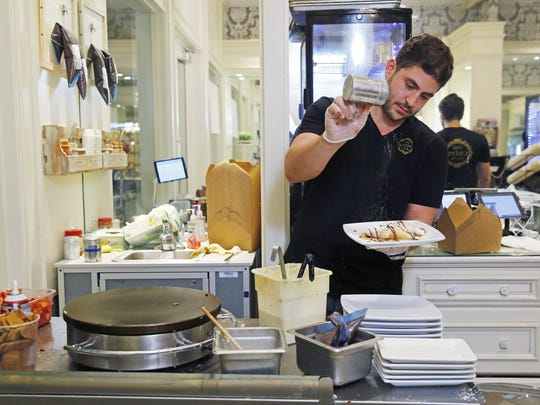 Fares Tarabichi  makes crepes at the Crepe Club on Nov. 6, 2016, at Biltmore Fashion Park  in Phoenix. The family started the Crepe Club two years ago as a food cart on the ASU Tempe campus. The crepes were so popular they soon had two carts and recently opened their restaurant at the Biltmore.