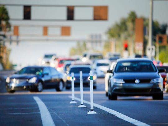 Lane barriers on the southbound side of McClintock Drive near the US 60 Monday, Nov. 7, 2016 in Tempe, Ariz.  Tempe's decision to restripe portions of McClintock Drive to add bicycles lanes has caused outrage among many residents because it reduced traffic lanes in some areas.