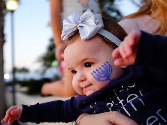 A child with menorah face-paint is seen Dec. 17, 2014, at the Community Public Menorah Lighting hosted by the Chabad Jewish Center of Martin and St. Lucie at Tradition Town Square in Port St. Lucie.