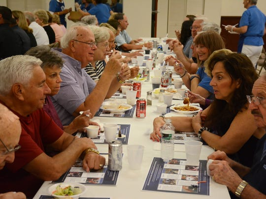 Diners tuck in, cafeteria style. The Knights of Columbus hosted a spaghetti dinner to benefit island first responders on November 18 at the San Marco Catholic Church parish hall.