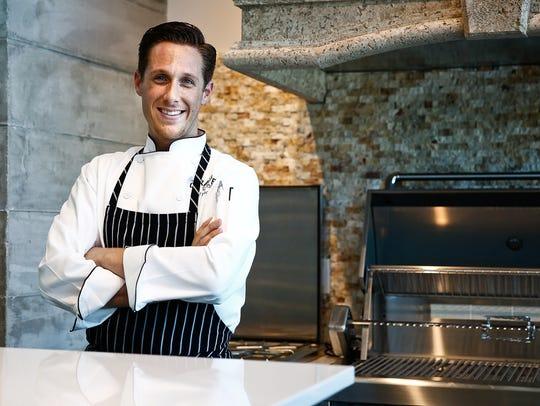 Naples chef Brian Roland stands for a portrait at Design