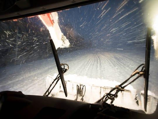 Crews work at Killington Resort during a snowstorm