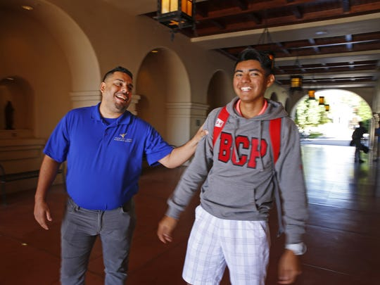Eddie Martinez visits with Juan Alvarado on Nov. 22,  2016, at Brophy College Prep in Phoenix.  Eddie mentors Juan, hoping to be the kind of support that James Foley was for him.