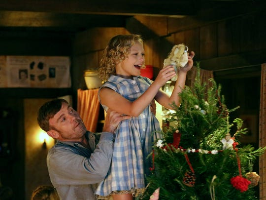 "From left, Ricky Schroder as Robert Lee Parton, Alyvia Alyn Lind as Dolly Parton in ""Christmas of Many Colors: Circle of Love."""