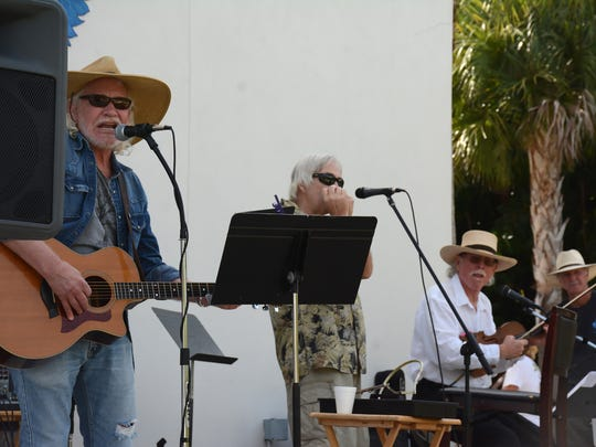 Merrill Allen, from left, Ben Olson and JRobert entertain. The Goodland Civic Association held their Holiday Bazaar Saturday morning at MarGood Harbor Park, with artwork and crafts on sale, live music and food.