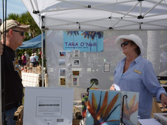 Painter Tara O'Neill is a fixture on the Goodland art scene. The Goodland Civic Association held their Holiday Bazaar Saturday morning at MarGood Harbor Park, with artwork and crafts on sale, live music and food.