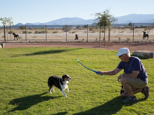 Steve Hellman plays with his dog, Ava, in the new Rancho