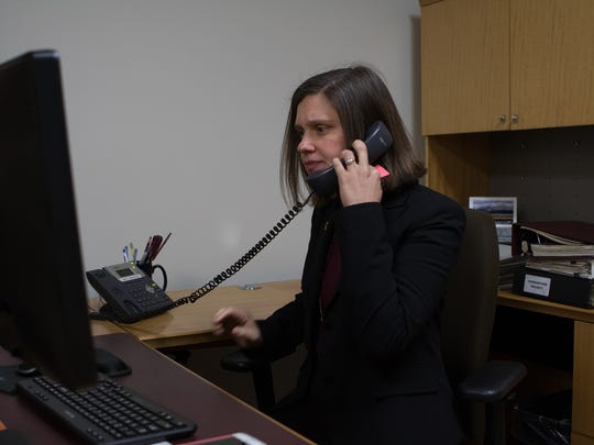 Ventura County Community Foundation CEO Vanessa Bechtel answers her phone at the foundation's building in Camarillo on Thursday afternoon.