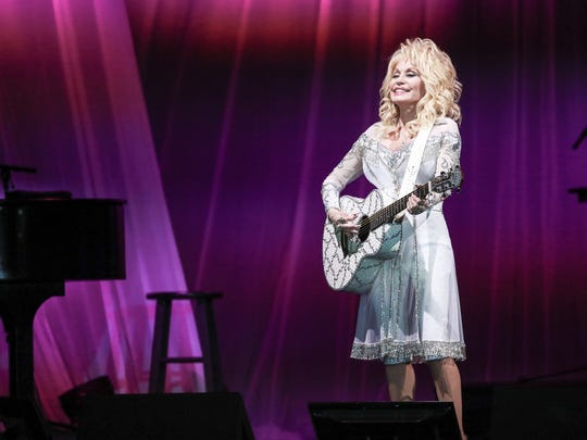 Dolly Parton performs at the American Bank Center on Friday, Dec.2, 2016. Parton, 70, grew up in rural Tennessee and first began singing in public in church.