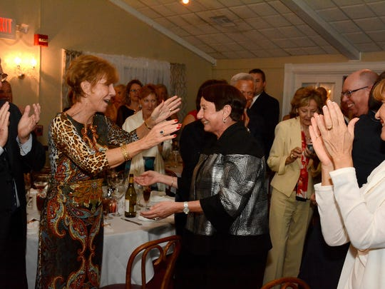 Volunteer of the Year Pat Rutledge is congratulated by Lori Wagor. The Marco Island Area Chamber of Commerce held its annual Christmas Gala Sunday at Bistro Soleil, announcing winners for the Lifetime Achievement Award, Citizen of the Year, Volunteer of the Year, and President's Recognition Award.