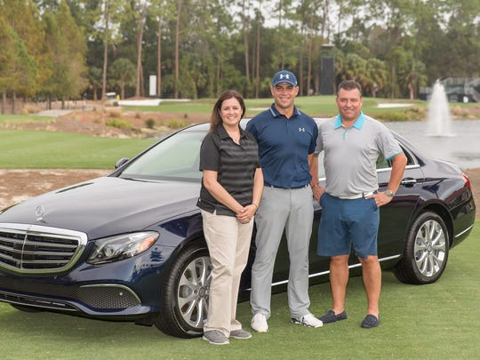 Gary Woodland, center, stands with Mercedes Benz representatives in 2016 after Woodland earlier in the day made a hole-in-one on No. 16 to win a Mercedes Benz during the Shootout pro-am.