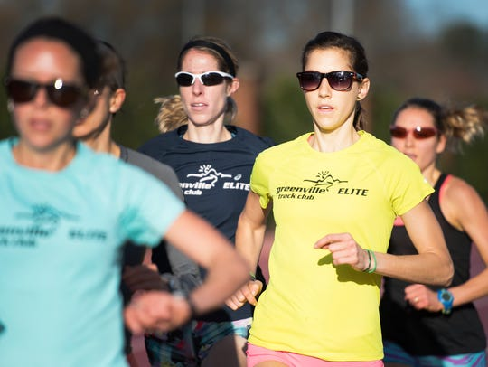 Kimberly Ruck runs with other members of the Greenville