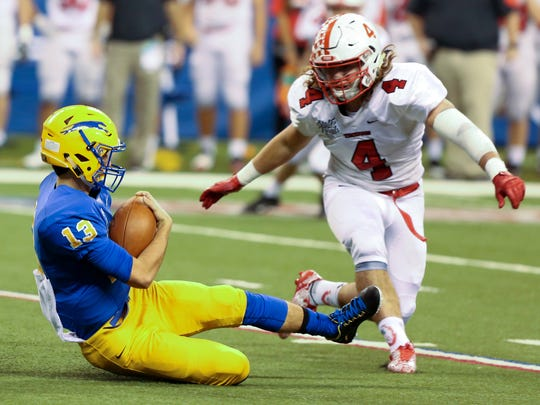 Center Grove linebacker Bailey Bennett (4) was key to the Trojans' run to the Class 6A title game.