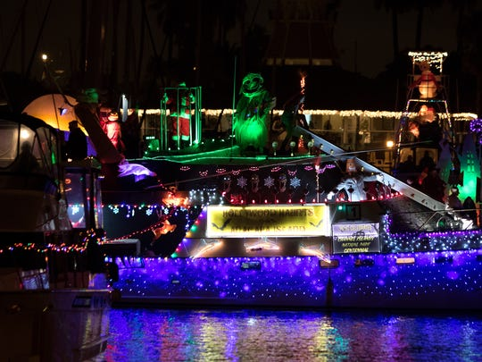 A boat decorated in Christmas lights is seen in the