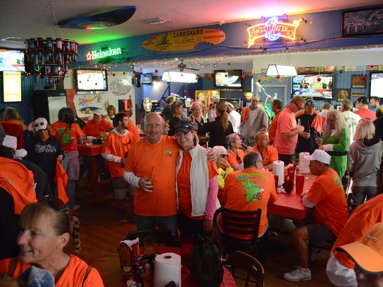 Before riders head out the Sandbar is a sea of orange. The Tour de Taverns bicycle poker run Saturday raised funds to help cancer patient Lisa Mayfield, a longtime supporter of the event.