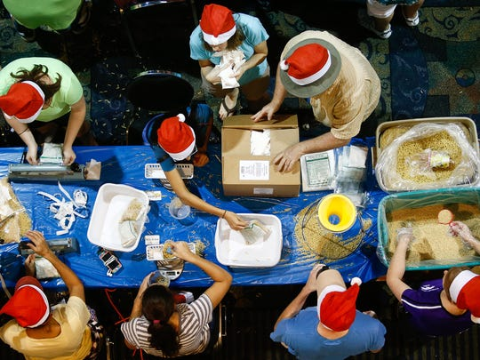 Over 2,000 volunteers filled Harborside Events Center in Fort Myers to help package meals for those in need for the 3rd annual Holidays Without Hunger event on Thursday, December 24, 2015.