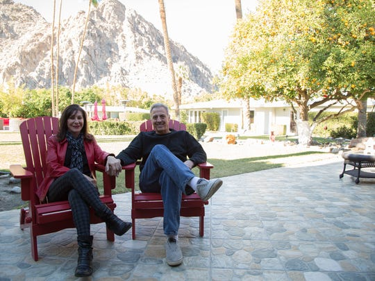 Lynne and Rob Daniels are photographed outside of their La Quinta home on Monday, Dec. 19. Their home is often rented for vacations and events, and it would be affected by changes to the La Quinta special events ordinance.