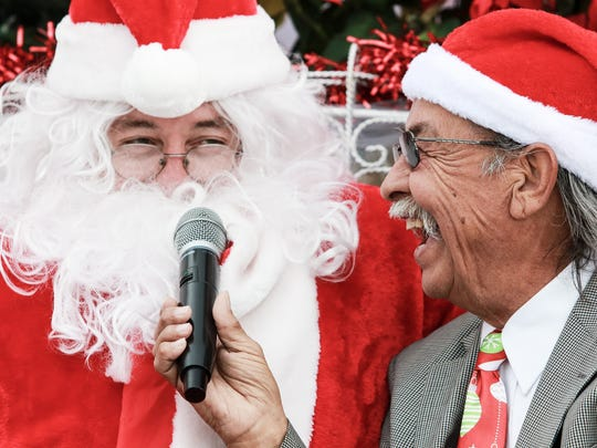 Santa jokes while being interviewed by Rey Madrigal