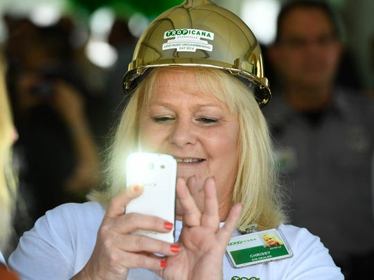 Tropicana Evansville employee Chrissy Zener takes pictures following Tuesday's  groundbreaking for a new $50 million land-based casino that will replace the riverboat that's been in use since 1995, July 19, 2016.