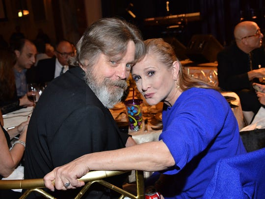 Actress Carrie Fisher, pictured with Mark Hammil at the Midnight Mission's 100 year anniversary Golden Heart Gala held at the Beverly Wilshire Four Seasons Hotel on Sept. 30, 2014 in Beverly Hills, California. Fisher died Dec. 27 in Los Angeles, California. Fisher suffered a heart attack December 23 during a flight from London to Los Angeles. She was 60.